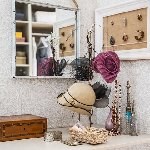 Room, Hat, Costume accessory, Lavender, Interior design, Beige, Still life photography, Cabinetry, Home accessories, Natural material,
