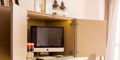 Furniture, Room, Interior design, Orange, Property, Computer desk, Desk, Table, Living room, Yellow,
