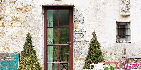 Window, Table, House, Fixture, Outdoor table, Outdoor furniture, Door, Conifer, Wood flooring, Flowerpot,
