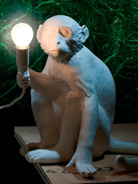 Sculpture, Candle holder, Art, Candle, Foot, Statue, Creative arts, Bear, Toe, Animal figure,