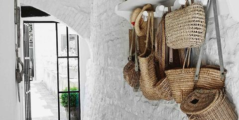 Wall, Room, Interior design, Beige, Furniture, House, Basket, Wicker, Wood, Shoe,