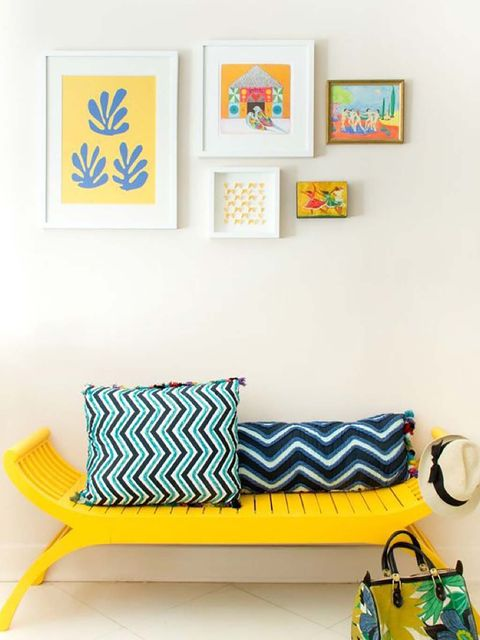 Yellow, Furniture, Room, Wall, Couch, Interior design, Living room, Rectangle, Wall sticker, Shelf,