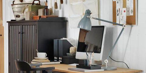 Room, Table, Furniture, Desk, Drawer, Writing desk, Lamp, Computer desk, Plywood, Display device,