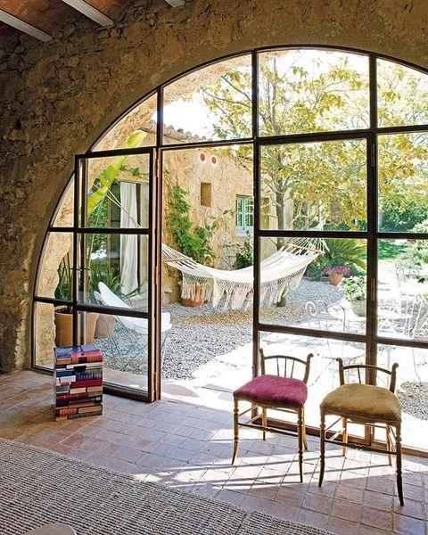 Fixture, Daylighting, Arch, Shade, Cobblestone, Brick, Outdoor furniture,