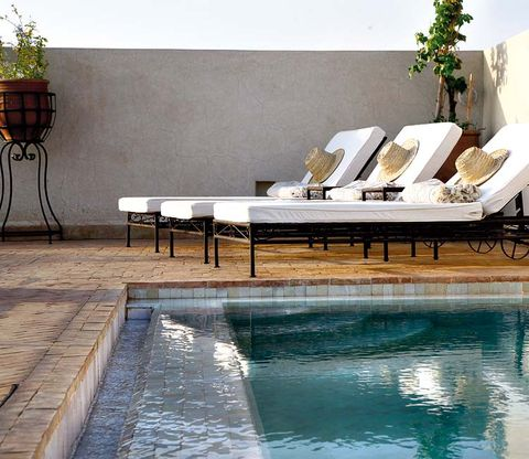 Fluid, Swimming pool, Reflection, Tile, Composite material, Outdoor furniture, Rectangle, Design, Water feature, Marble,
