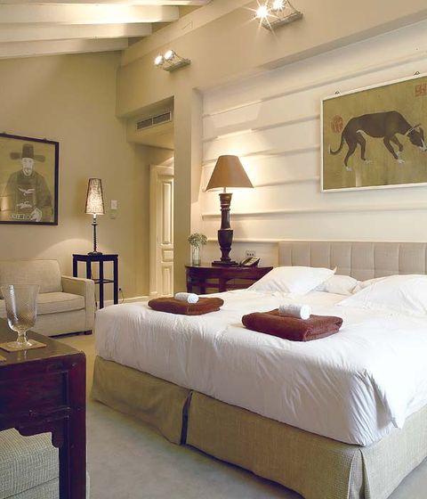 Lighting, Room, Bed, Interior design, Property, Textile, Furniture, Bedding, Wall, Bedroom,