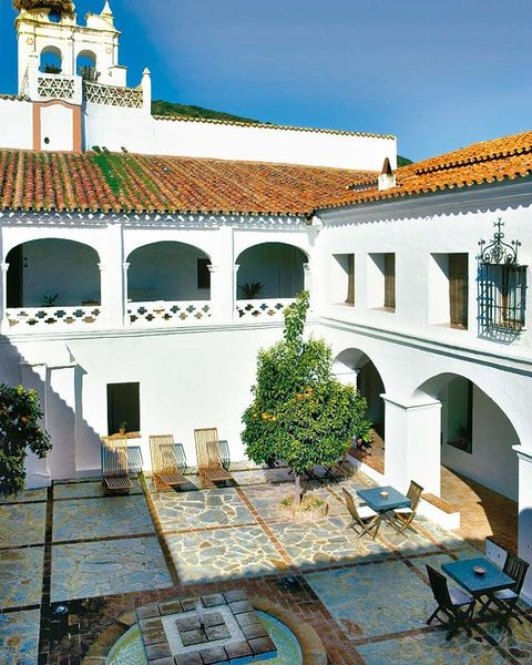 Place of worship, Courtyard, Hacienda, Arch, Urban design, Outdoor furniture, Holy places, Finial, Idiophone,