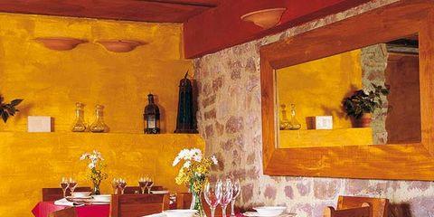 Yellow, Room, Table, Interior design, Furniture, Tablecloth, Chair, Interior design, Restaurant, Hardwood,