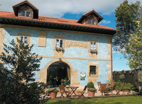 House, Building, Real estate, Roof, Door, Brick, Outdoor furniture, Home, Outdoor table, Brickwork,