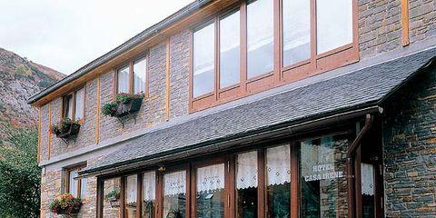 Window, Fixture, House, Door, Groundcover, Shrub, Cobblestone, Annual plant, Perennial plant, Inn,