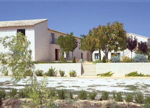 Plant, Property, Neighbourhood, Residential area, House, Real estate, Land lot, Home, Facade, Shrub,