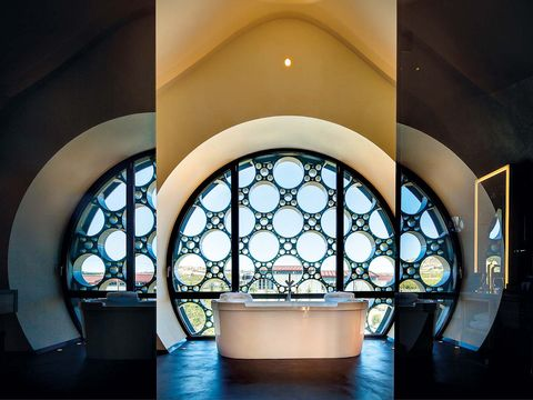Blue, Architecture, Interior design, Glass, Arch, Fixture, Tints and shades, Daylighting, Stained glass, Light fixture,