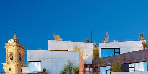 Architecture, Blue, Sky, House, Building, Property, Residential area, Home, Yellow, Facade,
