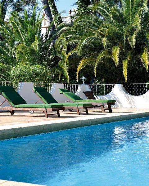 Swimming pool, Resort, Sunlounger, Outdoor furniture, Leisure, Aqua, Azure, Arecales, Composite material, Shade,