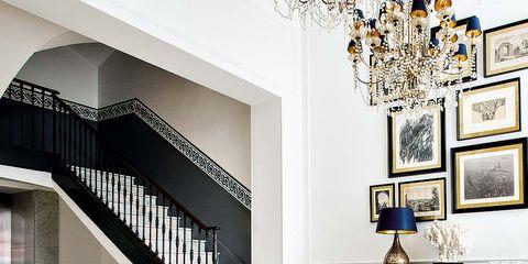 Room, Interior design, Stairs, Wall, Floor, Flooring, Home, Interior design, Chandelier, Light fixture,