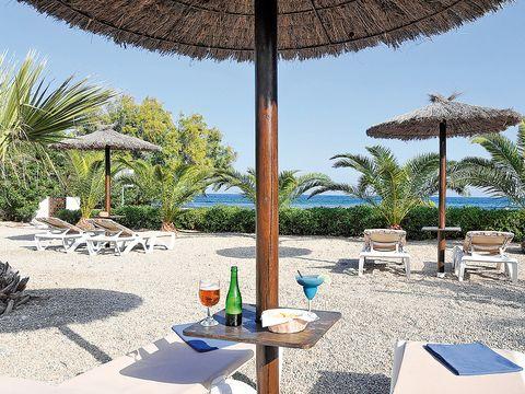 Outdoor furniture, Furniture, Shade, Outdoor table, Resort, Outdoor structure, Umbrella, Landscaping, Sunlounger, Tropics,
