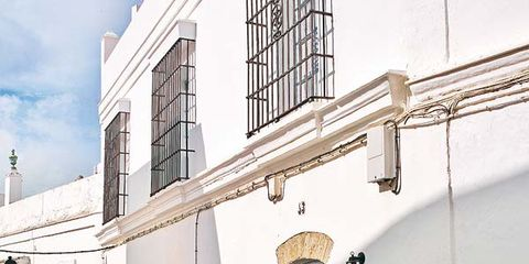 Wall, Door, Facade, Real estate, Fixture, House, Composite material, Home door, Material property, Concrete,