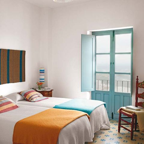 Room, Interior design, Green, Bed, Floor, Bedding, Textile, Bedroom, Wall, Furniture,