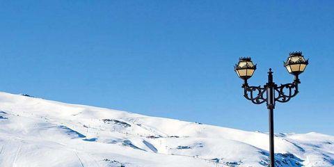 Winter, Mountain range, Street light, Slope, Snow, Outdoor furniture, Glacial landform, Mountain, Hill station, Light fixture,