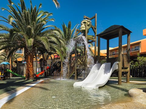 Public space, Landmark, Woody plant, Water feature, Arecales, Chute, Playground slide, Park, Nonbuilding structure, Palm tree,