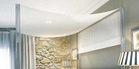 Bed, Lighting, Room, Interior design, Property, Bedding, Floor, Lamp, Textile, Wall,