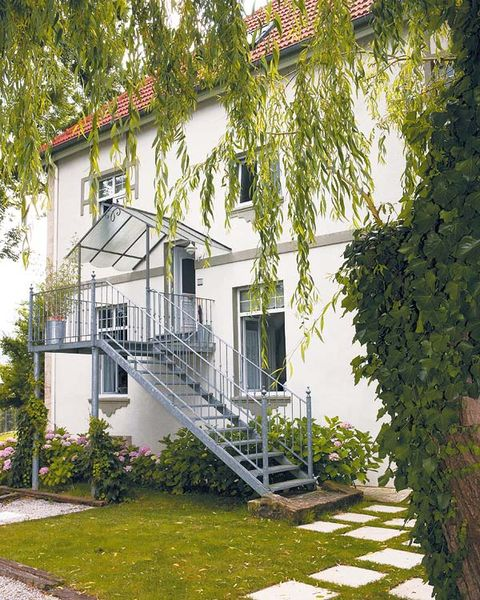 Stairs, Green, Plant, Property, House, Home, Real estate, Building, Residential area, Fixture,