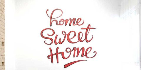 Red, Wall, Wall sticker, Room, Text, Font, Interior design, Furniture, Living room, Wallpaper,