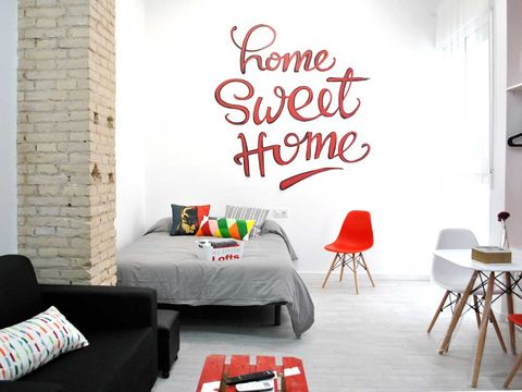 Wall, Room, Red, Living room, Interior design, Furniture, Wall sticker, Text, Font, Wallpaper,