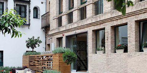 Window, Wood, Neighbourhood, Hardwood, Outdoor furniture, Flowerpot, Outdoor table, Brick, Courtyard, Armrest,