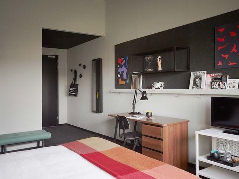 Room, Interior design, Display device, Furniture, Floor, Wall, Flooring, Computer keyboard, Drawer, Cabinetry,