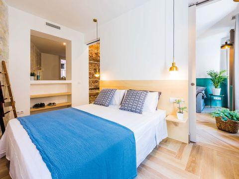 Bedroom, Furniture, Bed, Room, Property, Bed sheet, Interior design, Blue, Building, Wall,