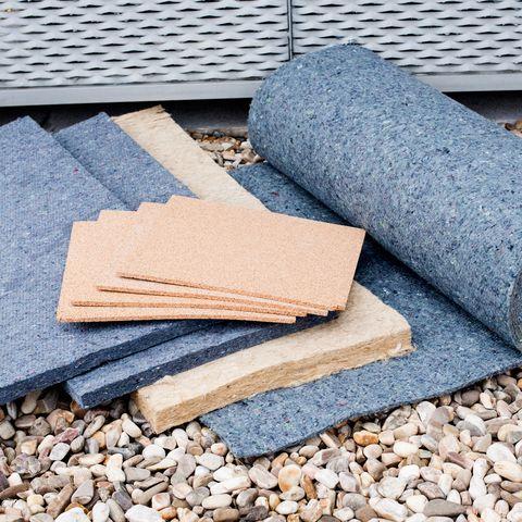 Pebble, Gravel, Beige, Rubble, Home accessories, Mat, Paper, Paper product, Natural material,