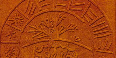 Artifact, Ancient history, Tan, Circle, History, Carving, Relief, Symbol,