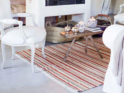 Floor, Room, Interior design, Flooring, Textile, Hat, White, Furniture, Table, Home,
