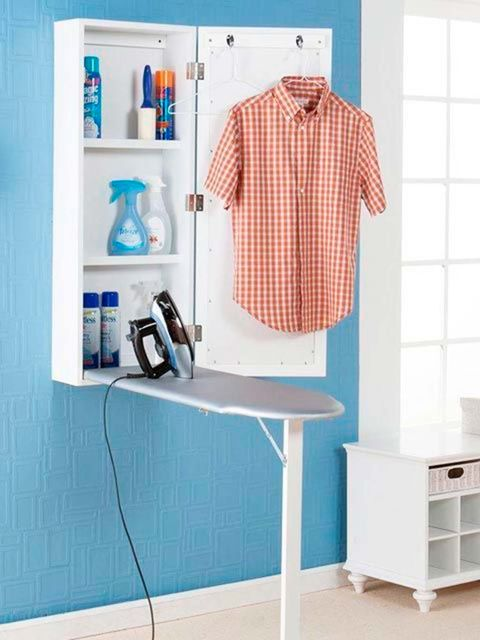 Shelf, Clothes hanger, Furniture, Room, Ironing board, Turquoise, Shelving,