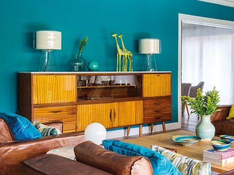 Furniture, Room, Living room, Blue, Interior design, Turquoise, Green, Teal, Aqua, Property,