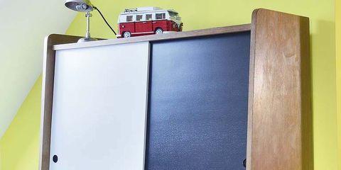 Room, Shelving, Wood stain, Paint, Plywood, Varnish, Still life photography, Toy vehicle, Automotive tail & brake light,