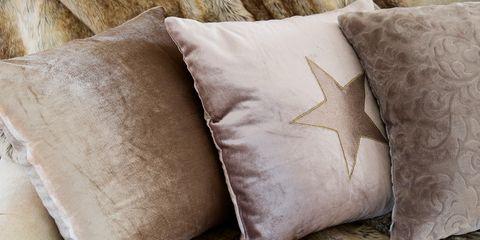 Pillow, Cushion, Throw pillow, Bedding, Furniture, Textile, Fur, Linens, Room, Beige,