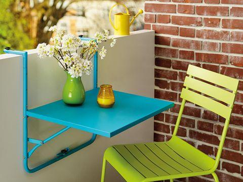 Yellow, Furniture, Table, Serveware, Chair, Outdoor furniture, Centrepiece, Vase, Teal, Interior design,