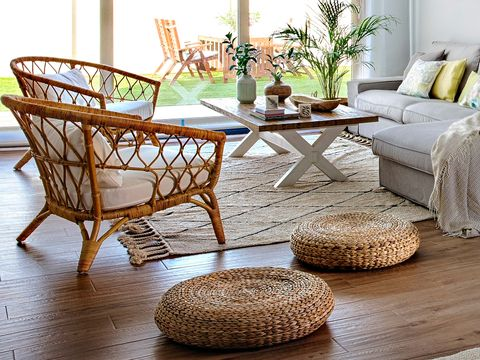 Furniture, Coffee table, Table, Room, Interior design, Chair, Floor, Wood flooring, Wicker, Living room,