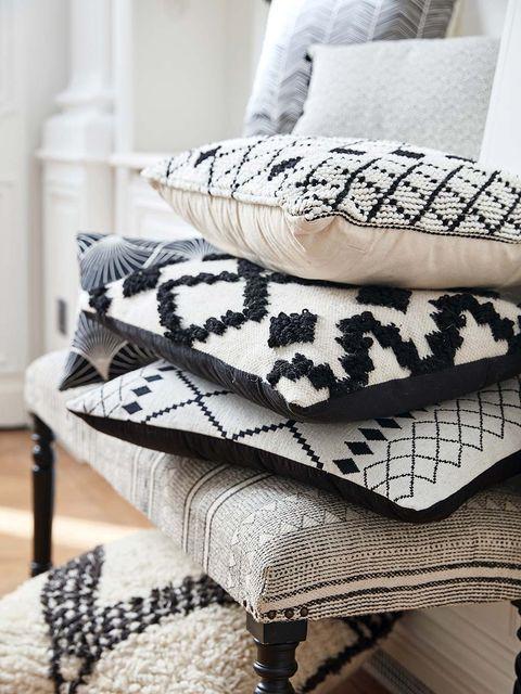 Furniture, Room, Interior design, Textile, Table, Bedding, Pillow, Pattern, Living room, Linens,
