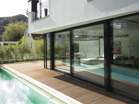 Property, Glass, Real estate, Fluid, Swimming pool, Transparent material, House, Residential area, Shade, Aqua,