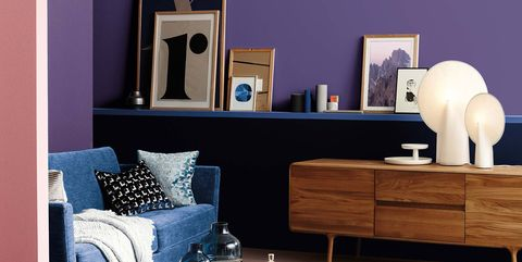Living room, Furniture, Room, Blue, Interior design, Coffee table, Table, Yellow, Shelf, Wall,