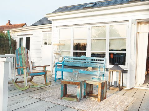 Furniture, Teal, House, Turquoise, Hardwood, Outdoor furniture, Home, Door, Outdoor table, Stool,