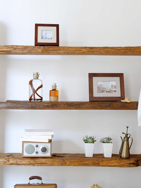 Wall, Interior design, Still life photography, Picture frame, Artifact, Houseplant, Flowerpot, Cross, Collection, Religious item,