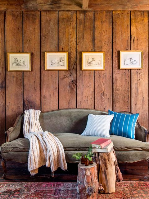 Wood, Brown, Hardwood, Wall, Room, Interior design, Couch, Wood stain, Living room, Pillow,