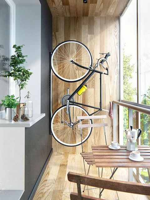 Bicycle wheel, Room, Wall, Bicycle, Yellow, Floor, Hardwood, Interior design, Wood, Ceiling,