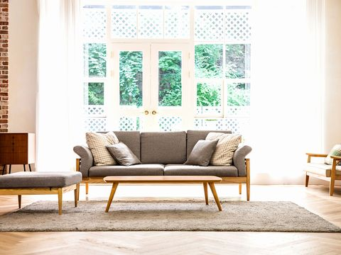 Furniture, Living room, Room, Couch, Interior design, Green, Coffee table, Wall, Table, Floor,