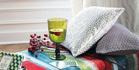 Interior design, Textile, Room, Glass, Drinkware, Interior design, Drink, Window treatment, Fixture, Linens,