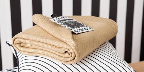 Brown, Hardwood, Beige, Home accessories, Cushion, Linens, Wood flooring, Throw pillow, Laminate flooring,